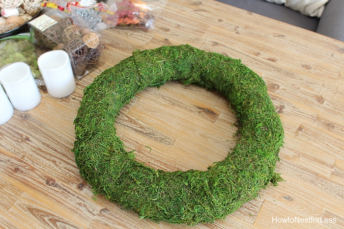 Pinning the moss to the wreath.