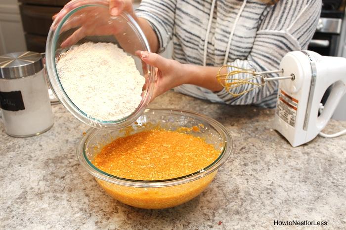 Combining the dry flour ingredients into the wet pumpkin ingredients.