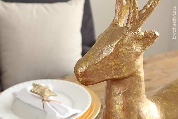 The face of the gold deer on the table.