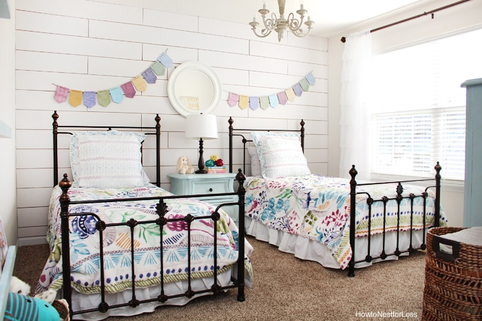 girl white planked wall bedroom