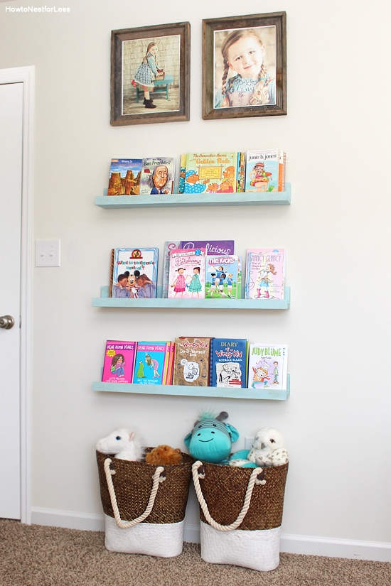 The bookshelves in a little girls room.