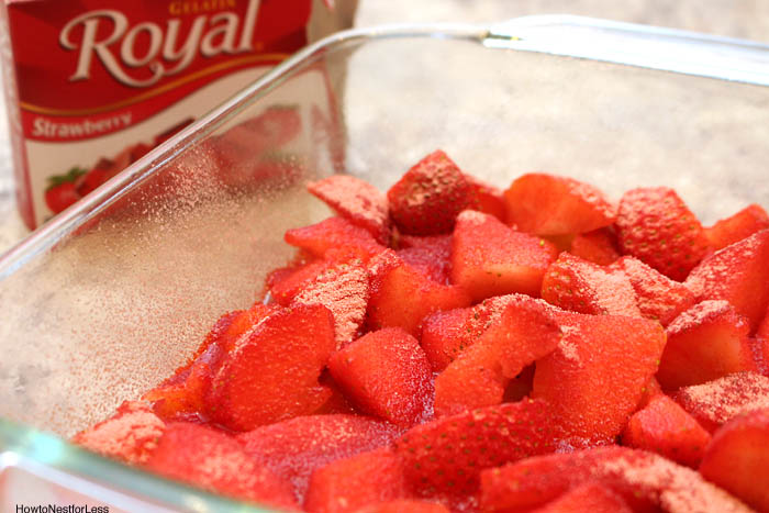 Strawberries in a clear glass cake pan.