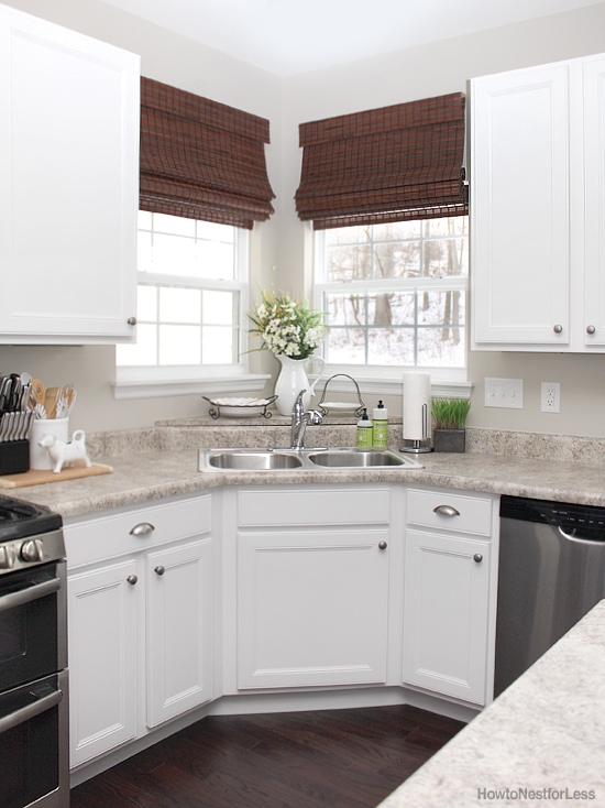 white cabinets dark flooring