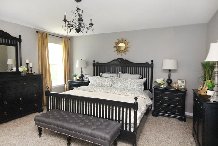 gold and black master bedroom