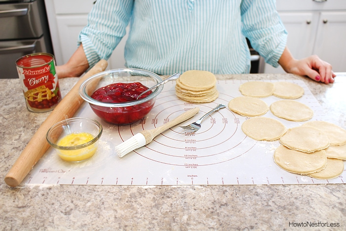 The dough circles and cherry pie filling and a pastry brush.