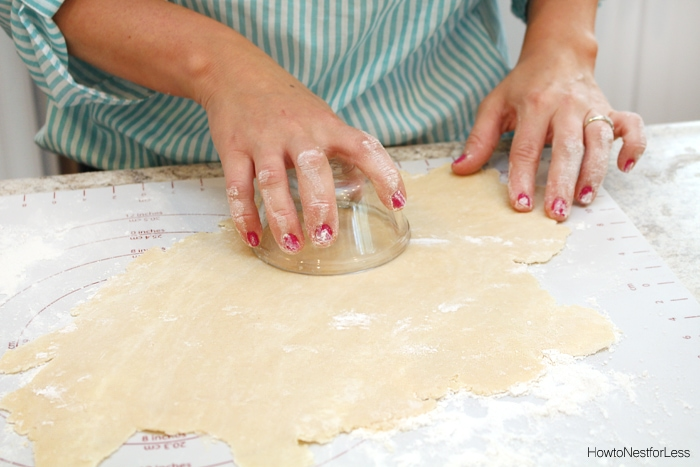 Cutting out the dough into circles.