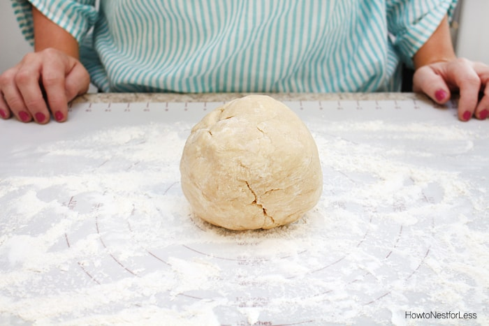 The dough in a ball on the floured counter.