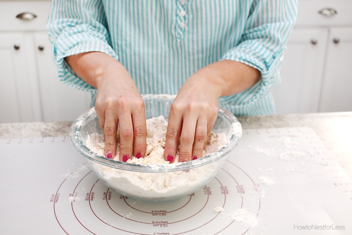 Mixing the dough by hand in a bowl.