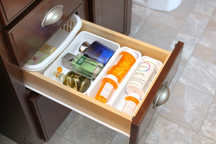 The middle drawer with cologne and medication.
