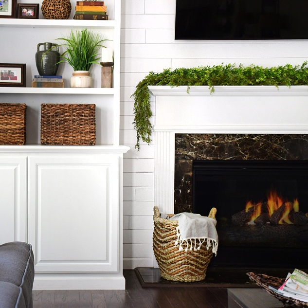 adding shiplap to built ins around fireplace in family room