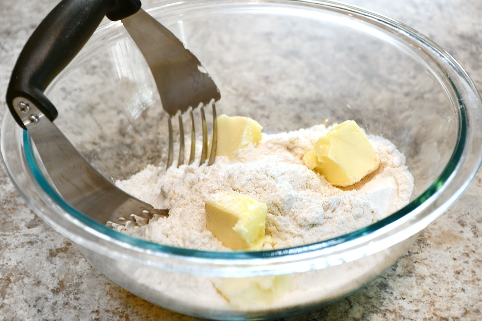 Mixing the butter and flour together.