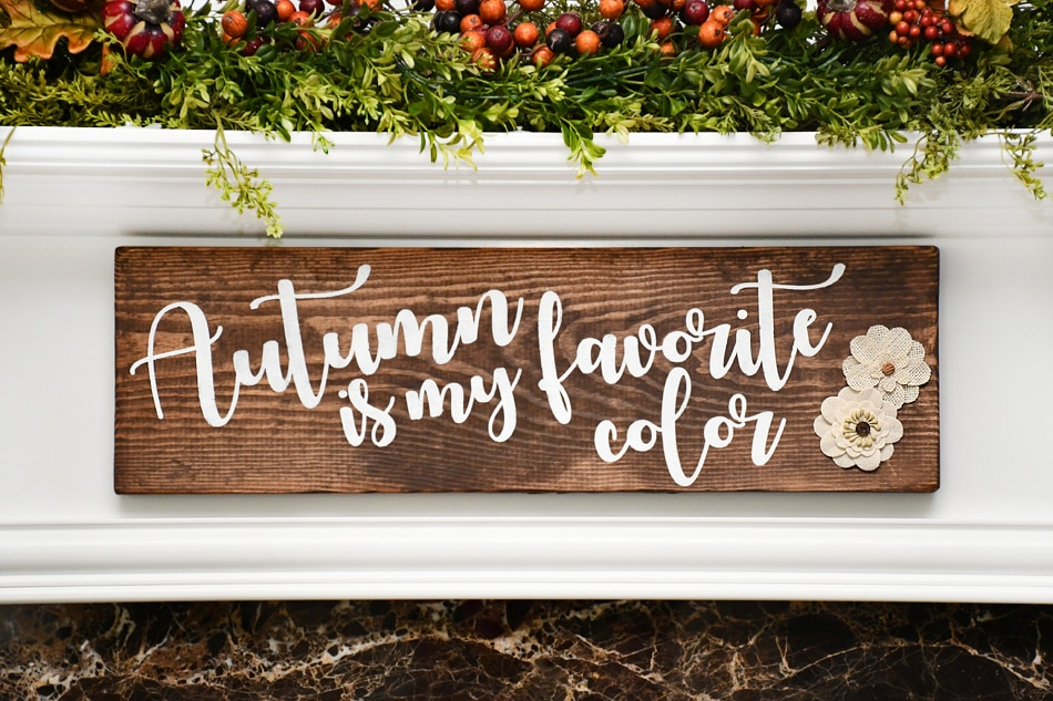 Autumn is my favorite color wood sign hanging above fireplace.