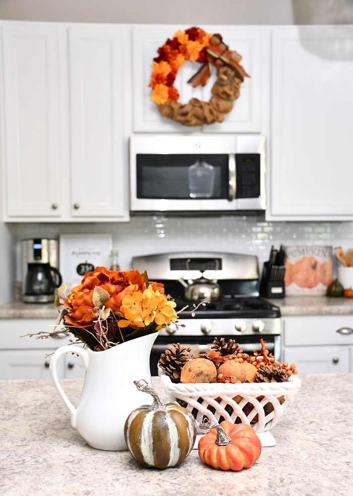 The Kitchen Island Got A Little Love With Some New Flowers Pumpkins And Sweet Smelling Fall Potpourri I Also Added Colorful Plates To Our Diy