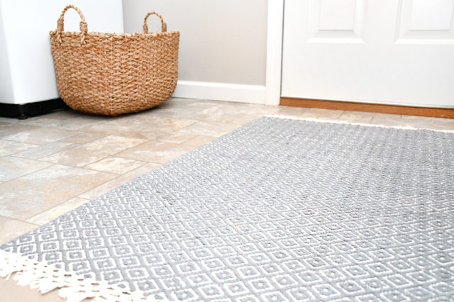 laundry room rug and seagrass basket