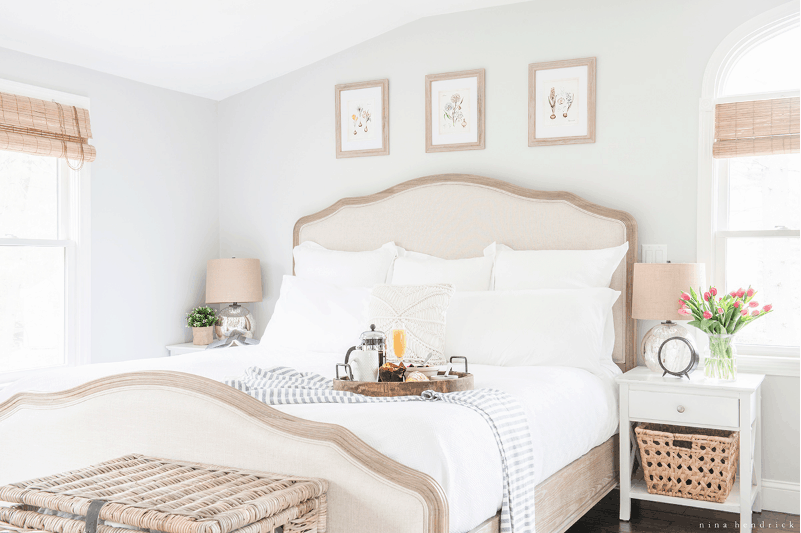 White and beige neutral toned bedroom.