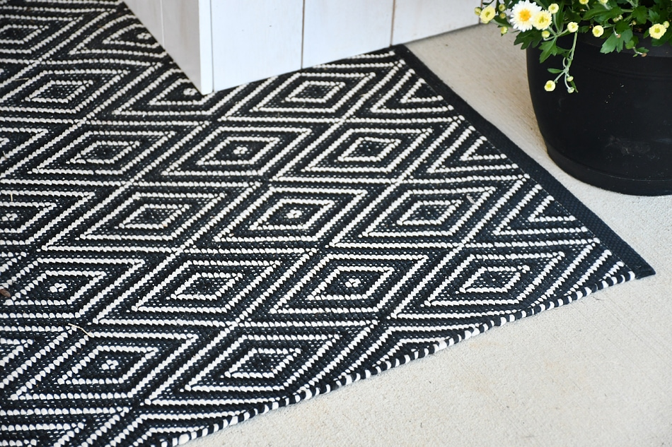 Black and white rug on front porch.