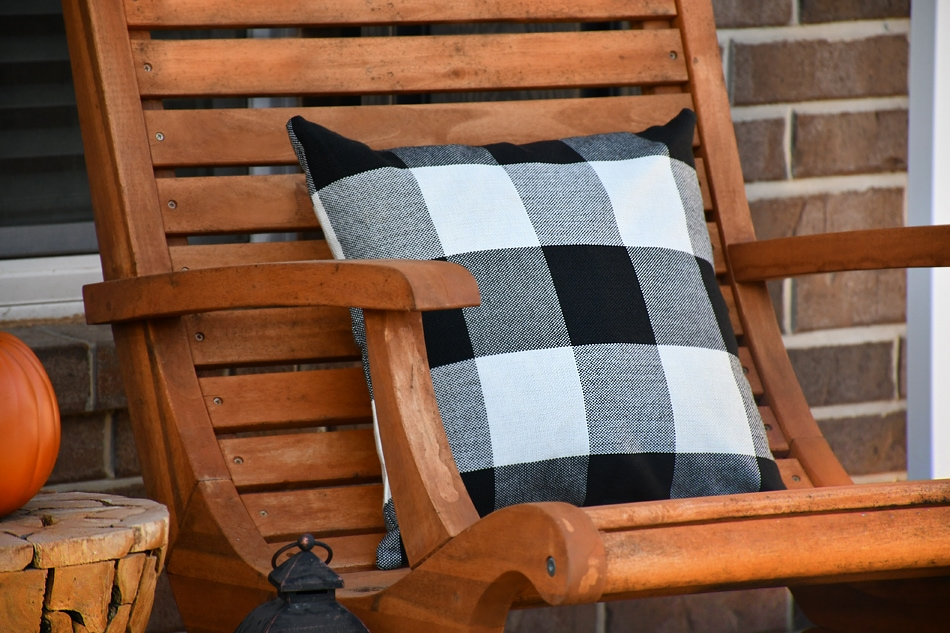 Up close picture of the black and white pillow on outdoor chair.