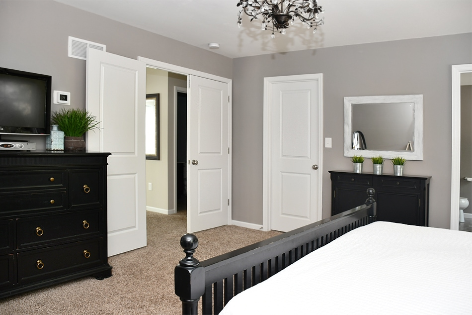 Budget master bedroom makeover with black furniture Master bedroom with grey furniture