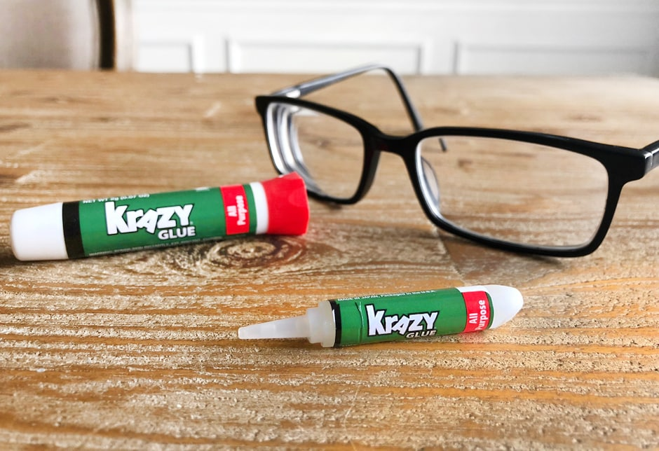 Eyeglasses on the counter with Krazy Glue beside them.