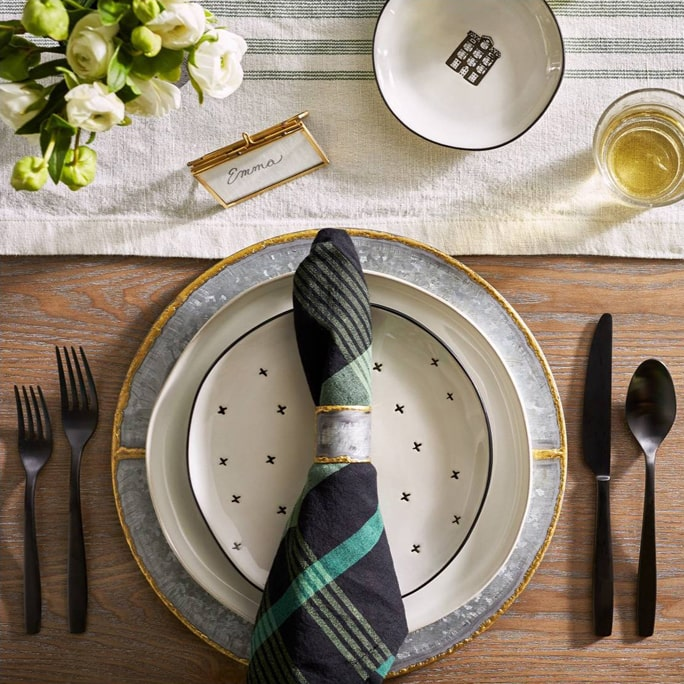 Plaid napkin on a dinner setting.