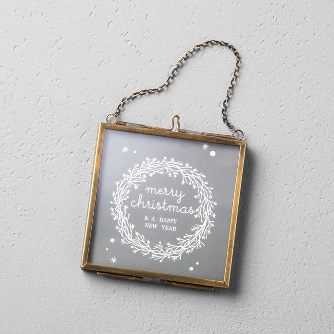 A glass photo frame ornament.