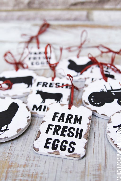 Farm fresh eggs with cows and tractors in black and white with red ties for the tree.