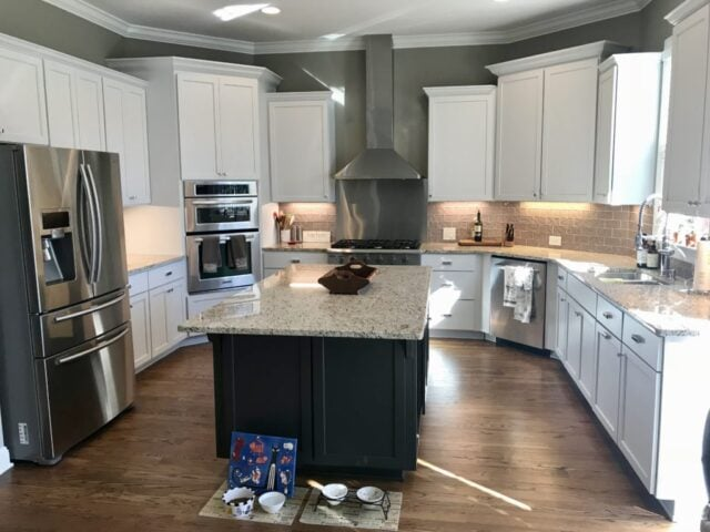 SW Iron Ore kitchen island with white upper and lower cabinets