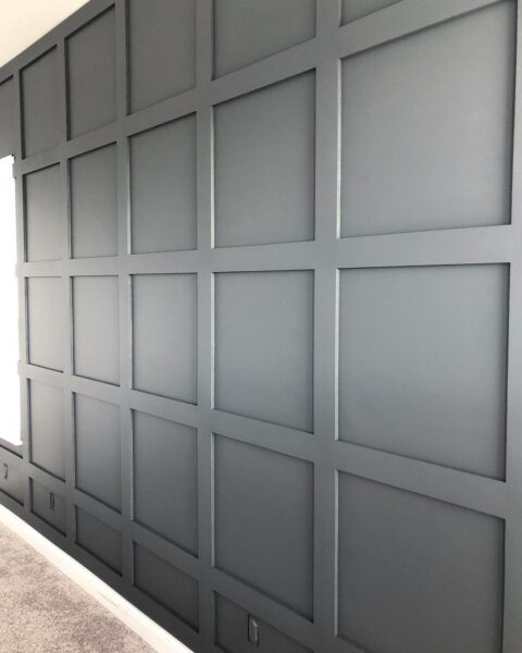 grid accent wall painted dark gray