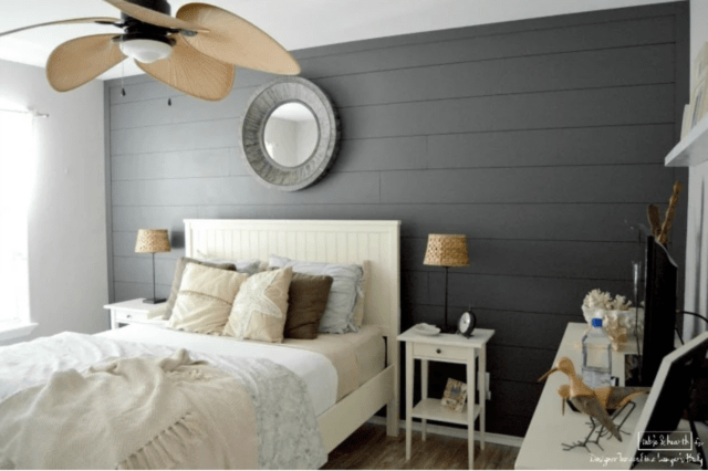 Dark gray shiplap accent wall with light bed and light nightstand